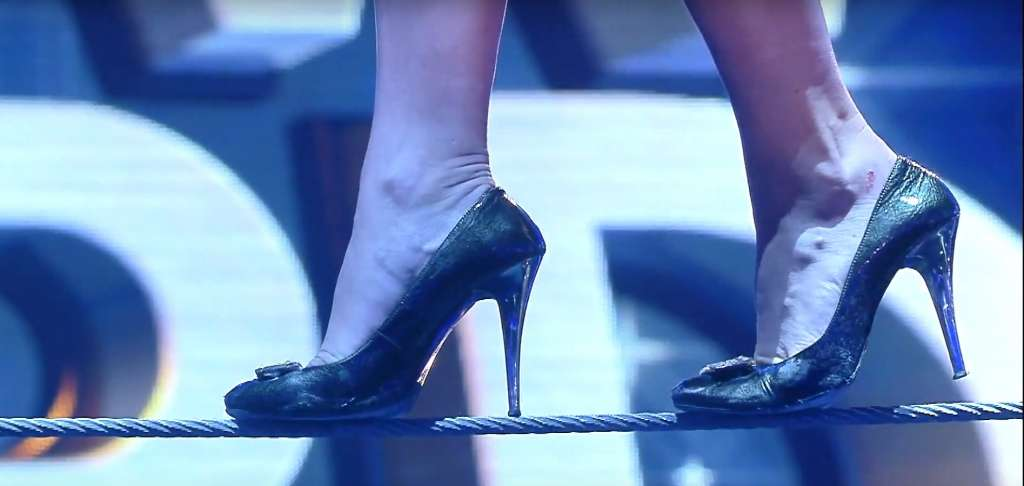 Watch this gorgeous lady set a world record for walking on rope in high heels