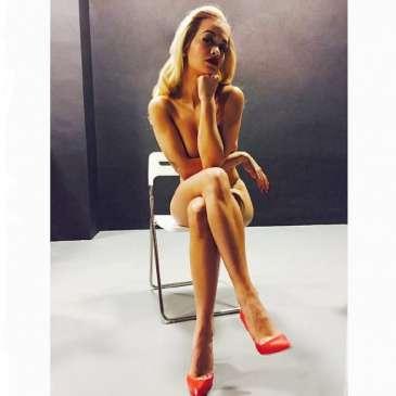 Rita Ora poses wearing nothing but high heels
