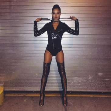 Shanina Shaik shows off her darker side in stunning thigh high boots for Halloween